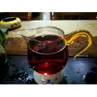 03年千年寨头春茶芽紧压357g熟普洱茶饼